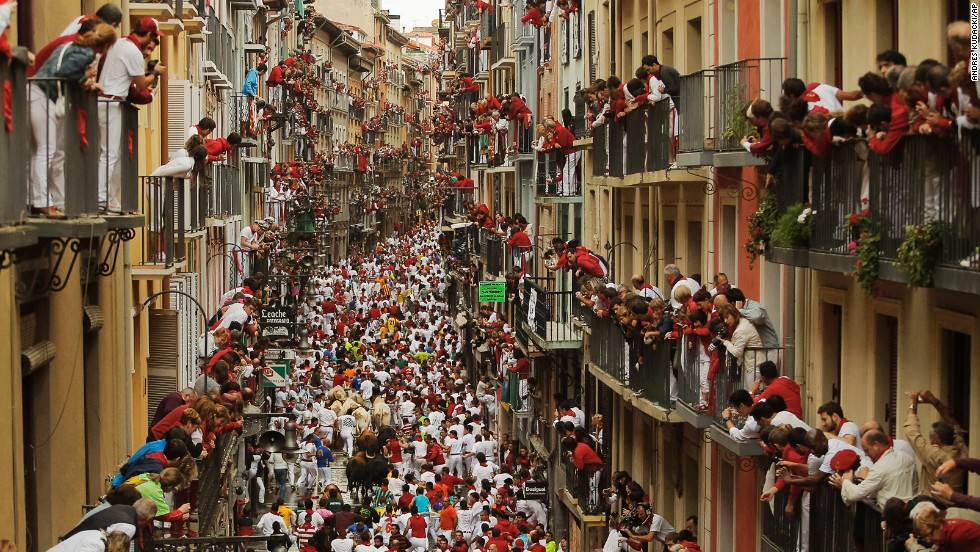 "From their balconies in Pamplona, Spain, people watch the San Fermin festival's annual <a href=""http://www.cnn.com/2014/07/07/world/gallery/running-of-the-bulls/index.html"">running of the bulls</a> on Saturday, July 12. The bull run is a 400-year tradition."