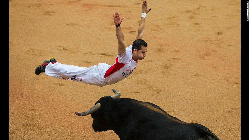 A ''recortador'' jumps over a bull during a competition at the festival on July 12. Recortadors leap over the bulls in a bloodless version of bullfighting where the one getting the closest and showing the least fear wins.