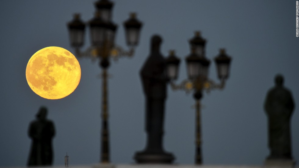"A ""supermoon"" is seen over a bridge in the center of Skopje, Macedononia, on Saturday, June 12.  The phenomenon occurs when the moon becomes full on the same day as its perigee -- the point in the moon's orbit when it's closet to Earth."