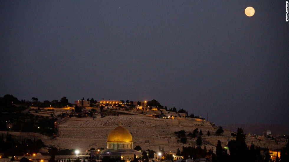 The moon over Jerusalem's Old City and the Dome of the Rock.