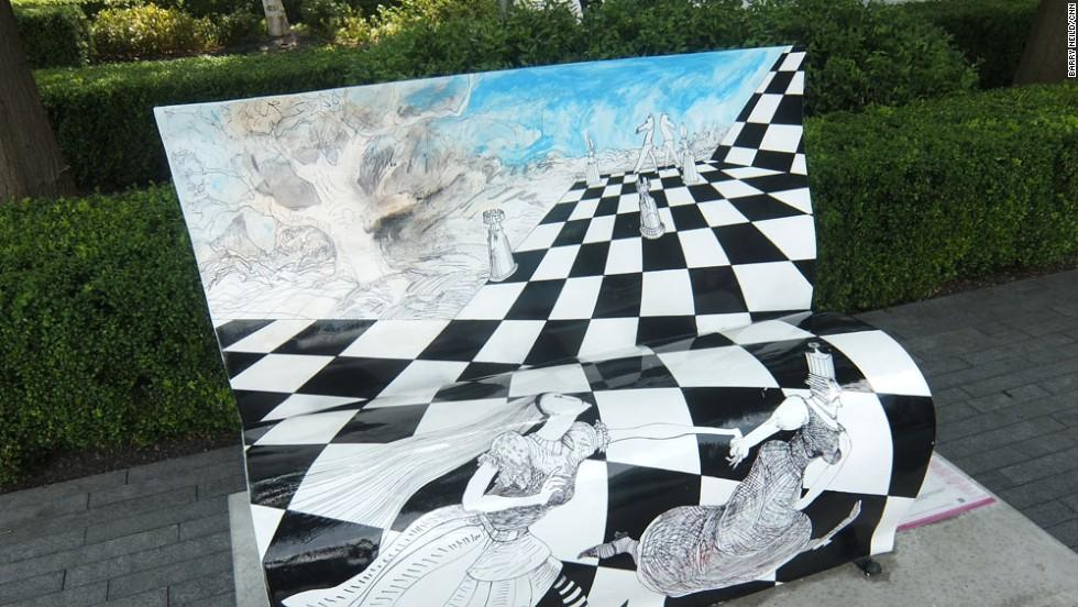 "The ""Alice in Wonderland"" bench near London's City Hallby was designed by surreal cartoonist Ralph Steadman."