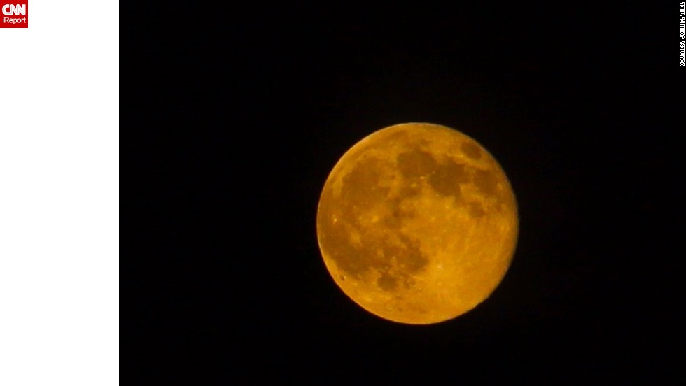 """""""As a photographer and astronomer, a full moon is typically nothing to get excited about for me unless it's going to be somehow unique, such as in color,"""" <a href=""""http://ireport.cnn.com/docs/DOC-1152100"""">John Thiel</a> of Astoria in Queens, New York, said. When he saw the amber coloring of the moon, he had to take a photo."""