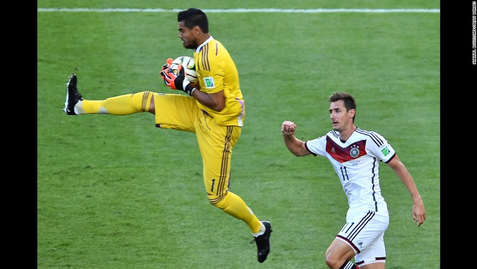Argentine goalkeeper Sergio Romero catches the ball in the first half.