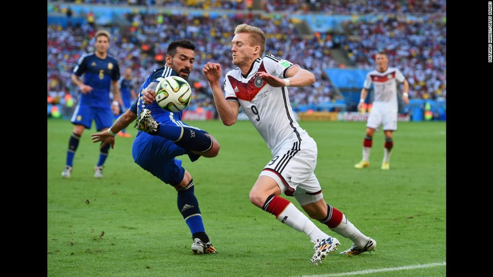 Argentina's Ezequiel Lavezzi, left, and Schurrle compete for the ball.
