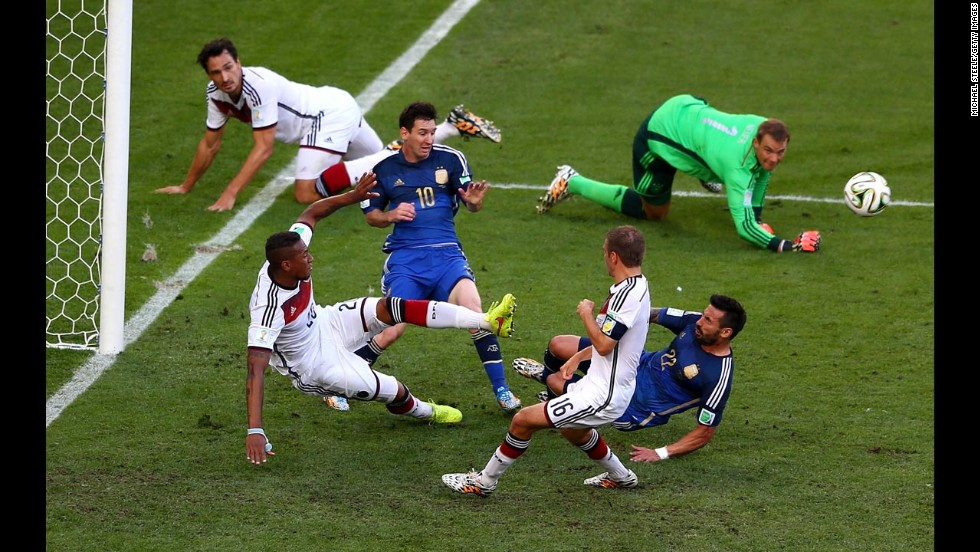 Boateng, bottom left, clears the ball as Messi and Lavezzi threaten.