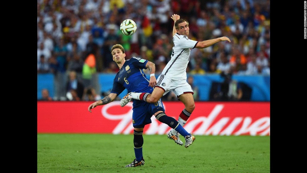 Biglia, left, and Germany's Philipp Lahm go up for a header.