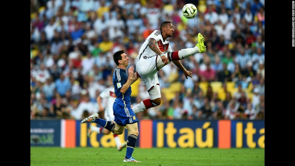 Boateng leaps for the ball.