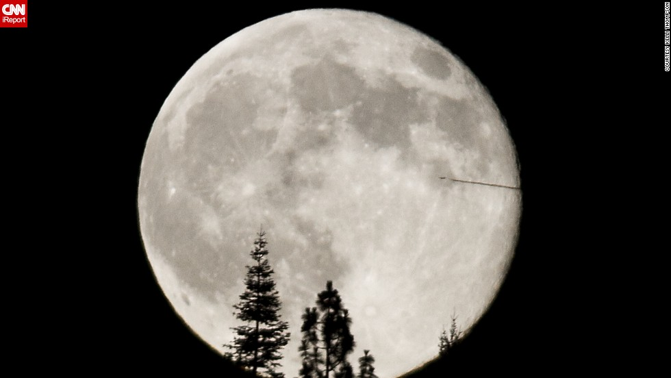 "<a href=""http://ireport.cnn.com/docs/DOC-1152039"">Kelli Thompson</a> photographed the supermoon from the foothills of the Sierra Nevada Mountains in California. ""The airplane bisecting the supermoon was quite unusual and unexpected,"" she said."