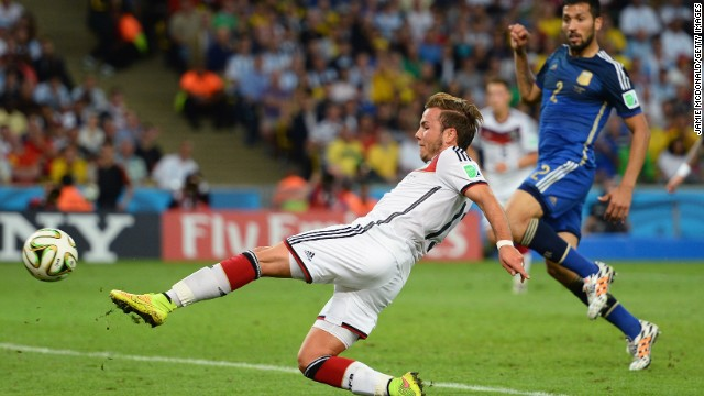 Mario Götze of Germany scores the only goal of the game during extra time during the World Cup final against Argentina at Maracana.