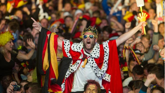 German soccer fans react after the deciding goal  for Germany in the final of  the Brazil World Cup 2014.