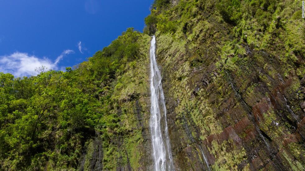Off the famous Hana Highway, nestled into the Kipahulu District of Maui's Haleakala National Park, is the 400-foot Waimoku Falls.