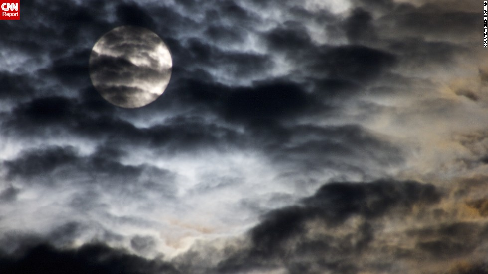 "Minister Glenn Daman shot this photo from his deck in Stevenson, Washington, as the moon<a href=""http://ireport.cnn.com/docs/DOC-1152267""> rose on the mountains</a> across the Columbia River Gorge. He was hoping to capture ""the surreal and haunting image that the cloud covere provided."" We'd say he succeeded!"