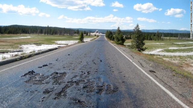 A road in Yellowstone National Park simmers in the heat of underground thermal features.