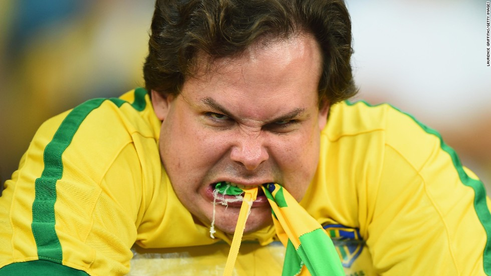 """An emotional Brazil fan reacts after the <a href=""""http://www.cnn.com/2014/07/08/worldsport/gallery/brazil-fans/index.html"""">shocking semifinal defeat.</a> It was Brazil's first loss in a competitive match at home since 1975."""