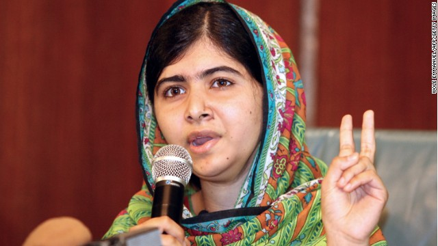 Caption:Pakistani education activist Malala Yousafzai gives a press conference on July 14, 2014 after meeting with the Nigerian president in Abuja. Malala on July 14 urged Nigerian President Goodluck Jonathan to meet with parents of the schoolgirls kidnapped three months ago by Boko Haram. Malala, who survived a Taliban assassination attempt in 2012 and has become a champion for access to schooling, was in Abuja on her 17th birthday to mark the somber anniversary of Boko Haram's April 14 abduction of 276 girls from a secondary school in the northeast Nigerian city of Chibok. AFP PHOTO / WOLE EMMANUEL (Photo credit should read WOLE EMMANUEL/AFP/Getty Images)