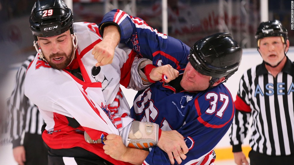 Justin Sawyer of Canada, left, and Kip Brennan of the United States fight during an International Ice Hockey Invitational game Friday, July 11, in Perth, Australia.