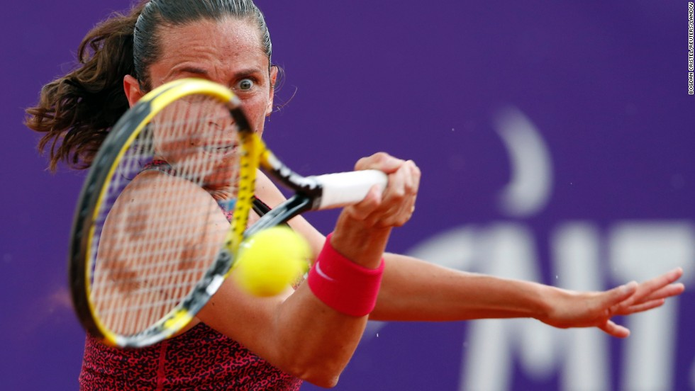 Roberta Vinci returns the ball to Kristina Kucova during their semifinal match at the Bucharest Open on Saturday, July 12, in Bucharest, Romania. Vinci won the match 6-1, 6-3.