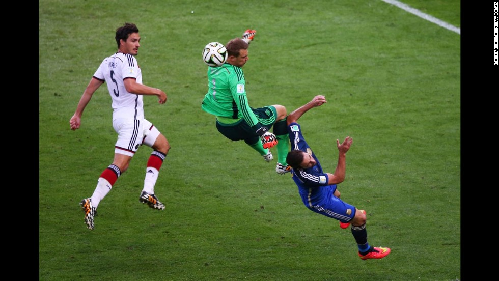 German goalkeeper Manuel Neuer, center, collides with Argentine forward Gonzalo Higuain during the World Cup final Sunday, July 13, in Rio de Janeiro. After Germany's victory, Neuer was awarded the Golden Glove for best goalkeeper in the tournament.