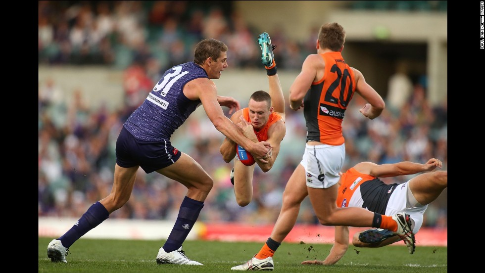 "Aaron Sandilands of the Fremantle Dockers, left, competes with Tom Scully of the Greater Western Sydney Giants during an Australian Football League match Sunday, July 13, in Perth, Australia. <a href=""http://www.cnn.com/2014/07/08/worldsport/gallery/what-a-shot-0708/index.html"">See 35 amazing sports photos from last week</a>"
