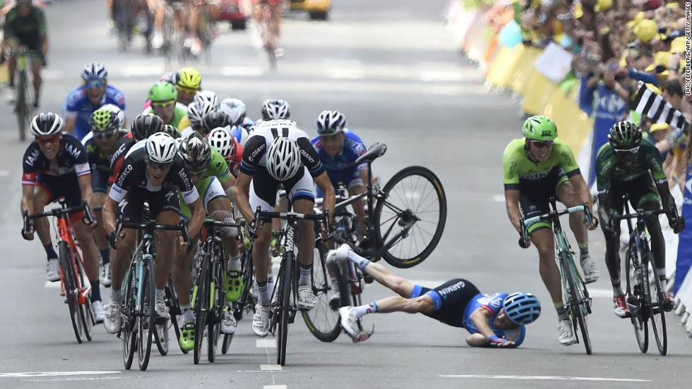 Andrew Talansky falls Friday, July 11, as cyclists sprint to the finish line of the Tour de France's seventh stage. Talansky suffered minor injuries but would go on to continue the race. Matteo Trentin won the stage, which ended in Nancy, France, after 234.5 kilometers (145.7 miles).