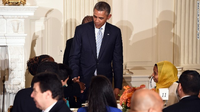 U.S. President Barack Obama hosts an Iftar dinner in the State Dinning Room at the White House in Washington on July 14, 2014.