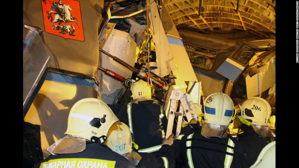 Rescuers work at the site of the accident on July 15. The rescue operation had become a recovery operation by the afternoon as emergency workers sought to free the remaining bodies from within the mangled train cars.