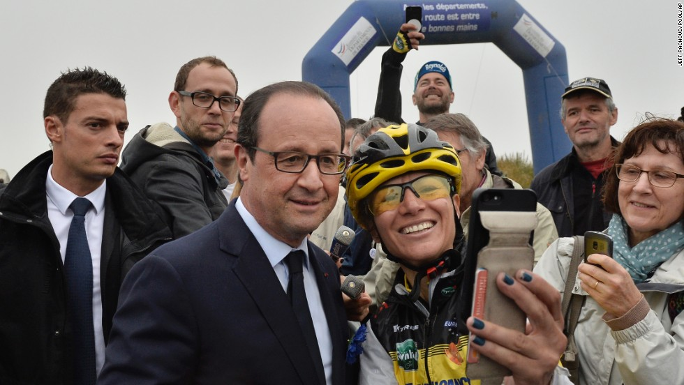 A cycling fan takes a selfie with French President Francois Hollande during Stage 6 of the Tour de France on Thursday, July 10. The stage, which started in Arras, France, and ended in Reims, France, spanned 194 kilometers (120.5 miles).