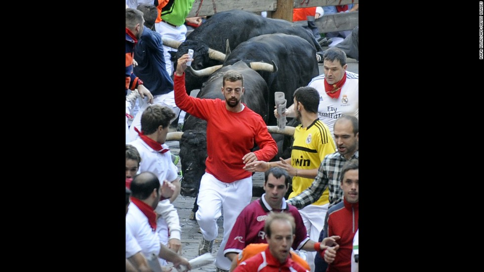 "A man takes a selfie Friday, July 11, as he participates in the annual <a href=""http://www.cnn.com/2014/07/07/world/gallery/running-of-the-bulls/index.html "">running of the bulls</a> in Pamplona, Spain. The bull run, a 400-year tradition, is part of the San Fermin festival. <a href=""http://www.cnn.com/2014/07/09/world/gallery/look-at-me-0709/index.html"">See 19 selfies from last week</a>"