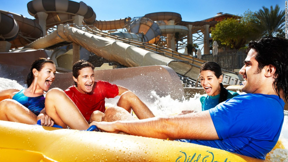 Surfing machines, water slides and an artificial waterfall refresh crowds in the desert heat at Wild Wadi Water Park in Dubai, named sixth-best water park.