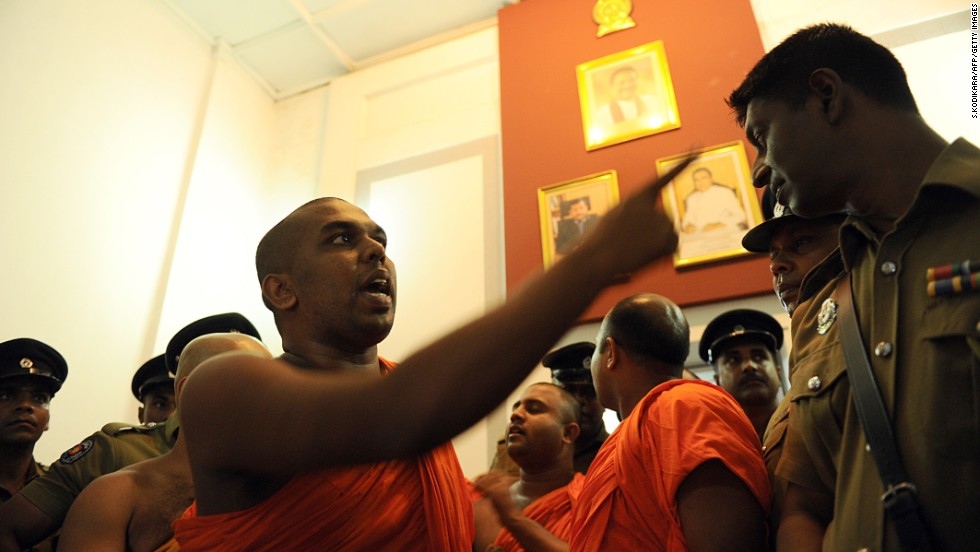 A monk belonging to the group debates with a police officer at the Trade Ministry in Colombo in April.