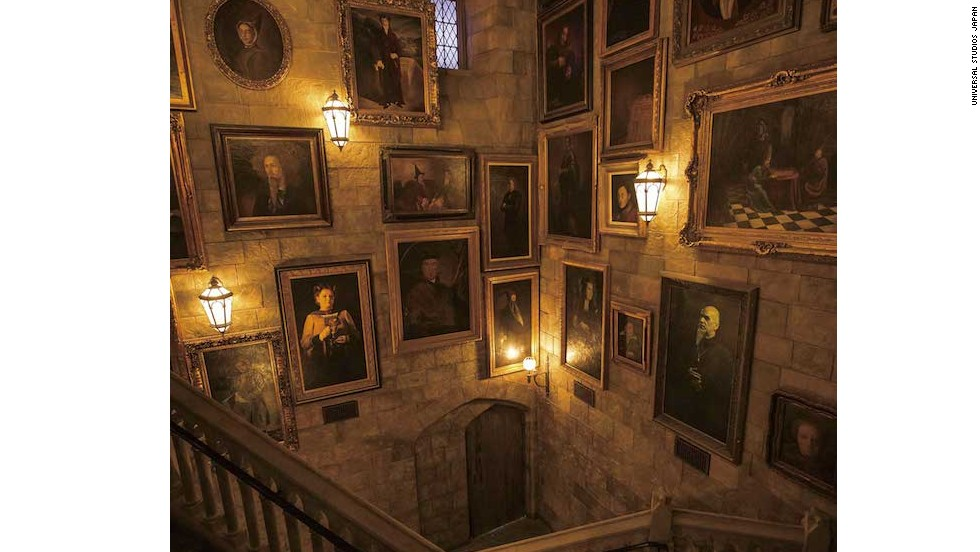 "Just like in the films, portraits line the walls of Hogwarts Castle in the Wizarding World of Harry Potter. Visitors walk through the gallery to get to the ""Harry Potter and the Forbidden Journey"" ride."