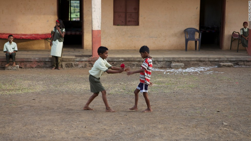 Lakhan plays tag with a classmate in his new home.