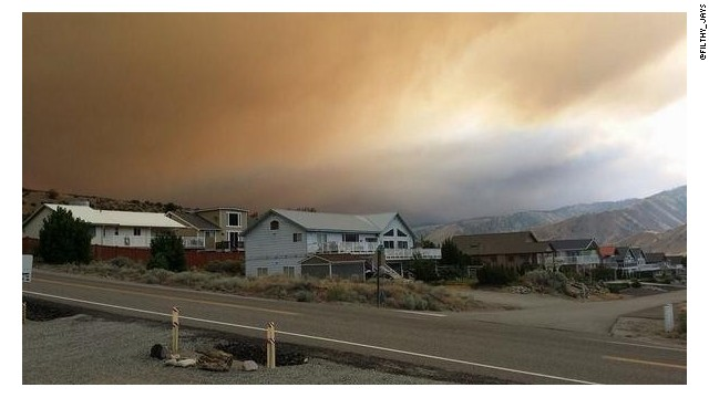 Smoke from a wildfire darkens the sky near Leanworth, Washington.