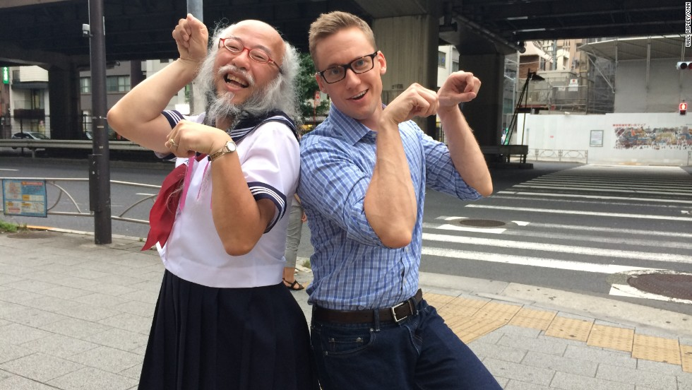 CNN correspondent Will Ripley makes an unsuccessful attempt to mimic Kobayashi's signature pose after interviewing him.