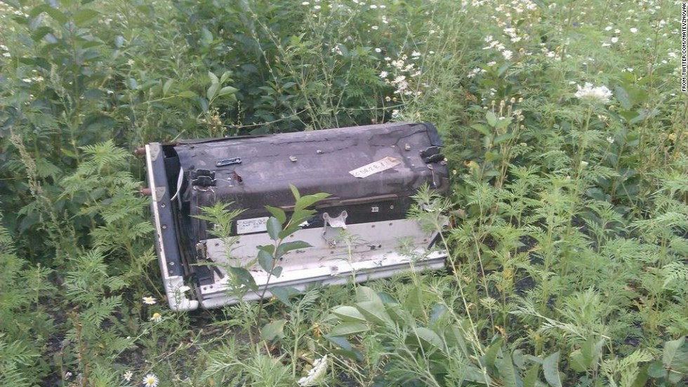 "A piece of wreckage believed to be from MH17. This image was posted to <a href=""https://twitter.com/MatevzNovak"" target=""_blank"">Twitter</a>."