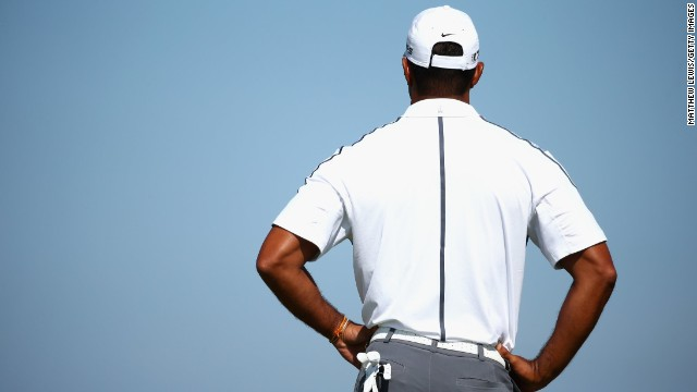 Tiger Woods is back in the game after crediting his physio with alleviating a dislocated bone in the base of his spine
