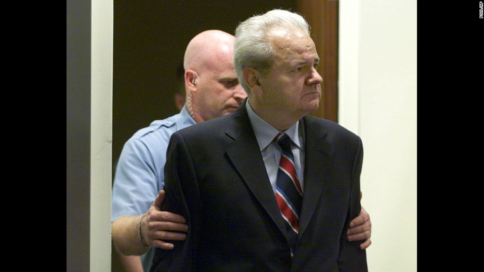 Former Yugoslav President Slobodan Milosevic enters the United Nations War Crimes Tribunal for the former Yugoslavia in The Hague in 2001. Milosevic was charged with war crimes, including genocide, and crimes against humanity in connection with the wars in Bosnia, Croatia, and Kosovo. His trial, which began in 2002, ended without a verdict when he was found dead in his prison cell in 2006.