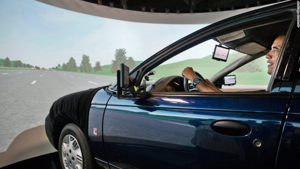 "President Barack Obama<a href=""http://politicalticker.blogs.cnn.com/2014/07/15/obamas-republican-road-rage/"" target=""_blank""> tests a car simulator</a> during a tour of the Turner-Fairbank Highway Research Center in McLean, Virginia, on Tuesday, July 15. The President, who hasn't been behind a steering wheel regularly since taking office, said the experience made him a little queasy. ""I think I had a little bit of a lead foot; I was starting to hit 90,"" he told a crowd afterward."