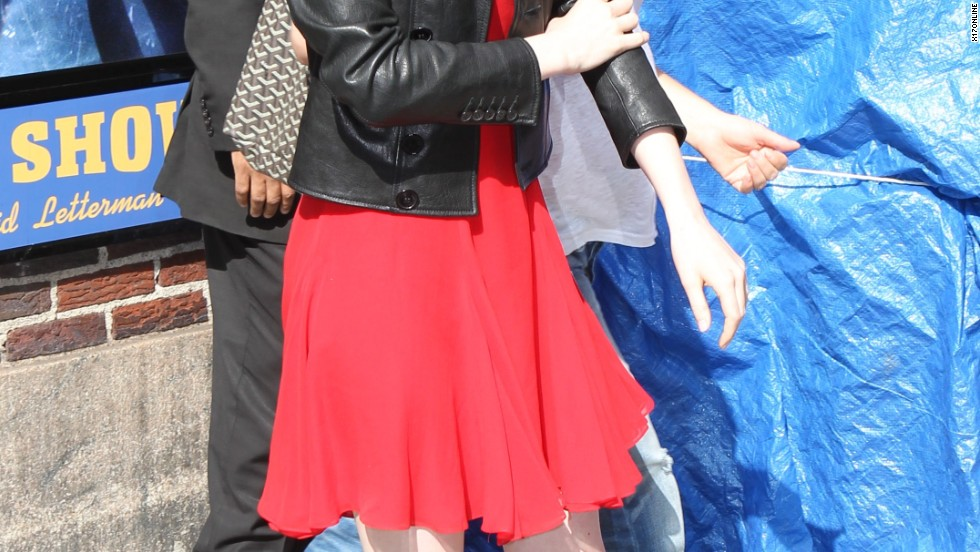 """Emma Stone's smile is almost brighter than NYC's sun as she leaves """"The Late Show with David Letterman"""" on July 16."""