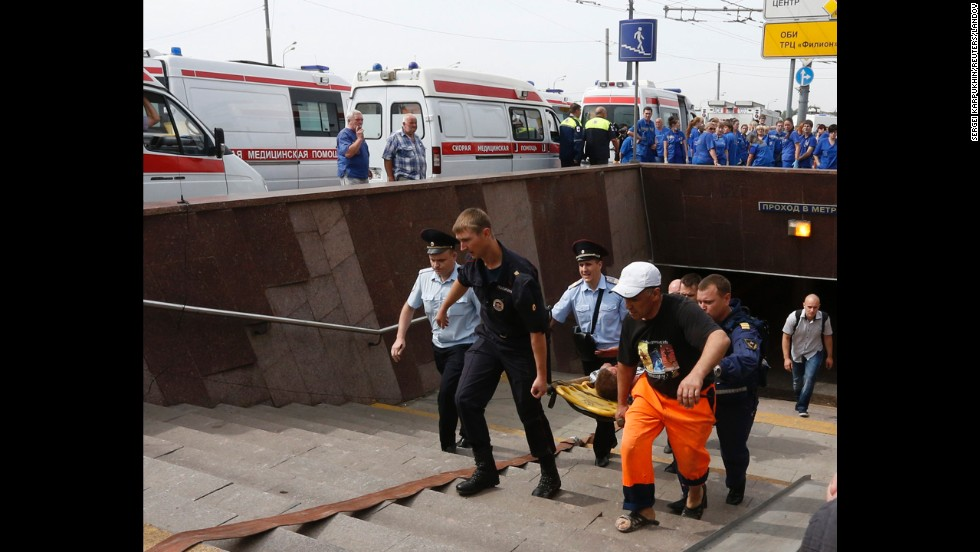 "Paramedics and firefighters carry an injured man after a<a href=""http://www.cnn.com/2014/07/15/world/gallery/moscow-train/index.html"" target=""_blank""> metro train derailed in Moscow</a> on Tuesday, July 15. It was not immediately clear what caused the derailment, which took place during morning rush hour in the Russian capital. At least 22 people were killed."