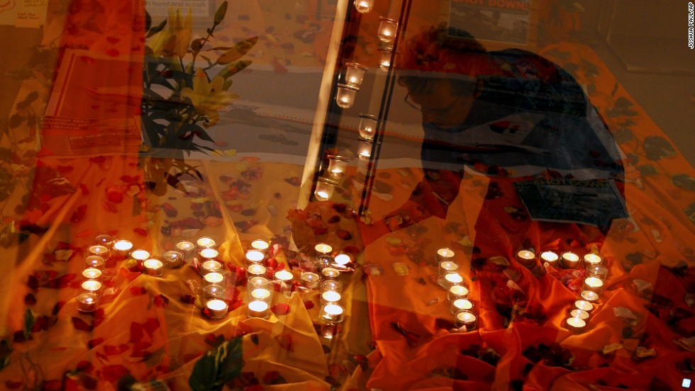 Candlelight prayers honor the victims at a church outside Kuala Lumpur on July 18.