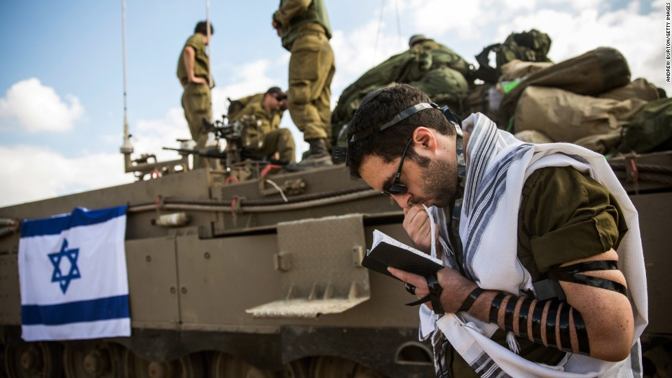 An Israeli reservist prays July 18 near the Gaza border by Sderot, Israel.