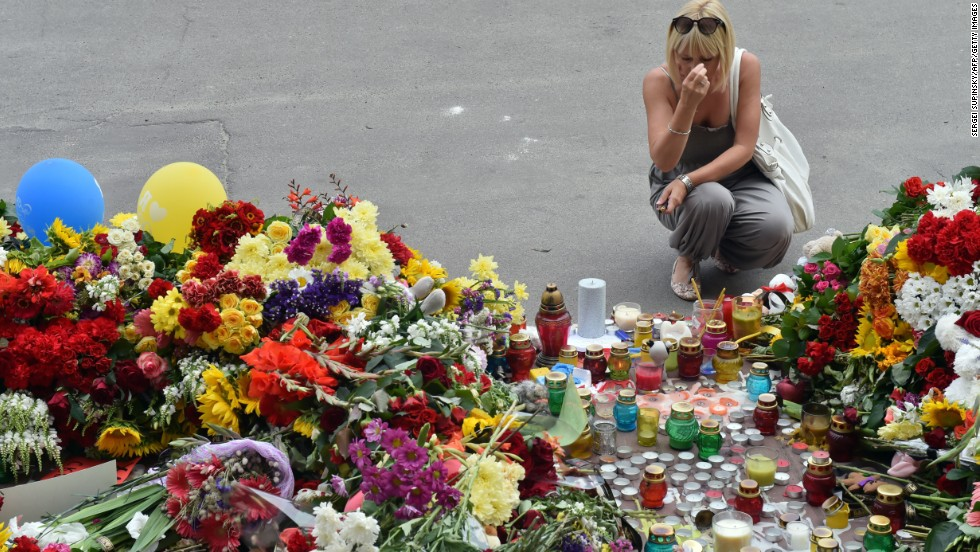 A woman grieves at a memorial in front of the Dutch Embassy in Kiev, Ukraine, on July 18.