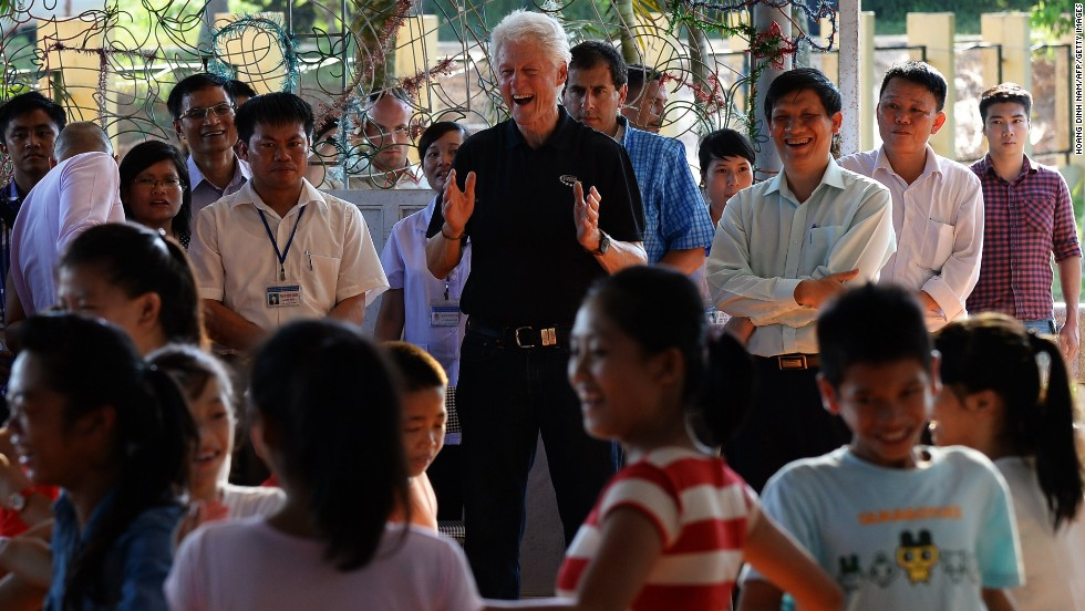 Clinton watches children dance during a visit to an orphanage with HIV-infected kids in the outskirts of Hanoi on July 18. The Clinton Health Access Initiative works with this and other sites in Vietnam to improve HIV care and treatment.