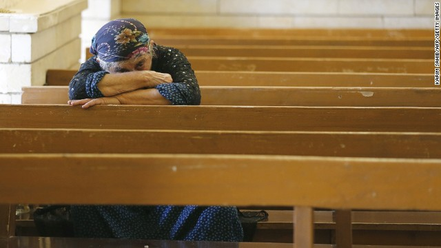 An Iraqi Christian prays at the Saint George church on July 1 in Erbil.