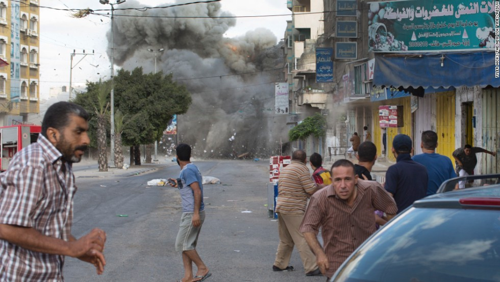 An explosion rocks a street in Gaza City on Friday, July 18.