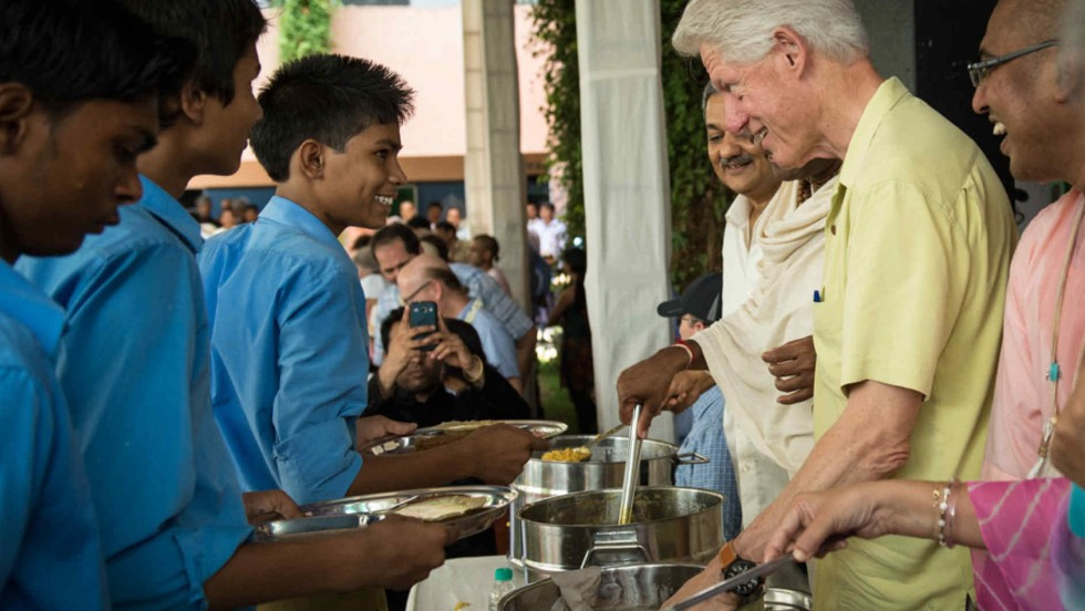 While in India, Clinton visited Jaipur Kitchen, part of a program supported by the Clinton Foundation that feeds more than 1 million kids a day in 10,500 schools across India.