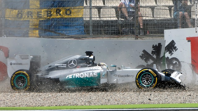 Lewis Hamilton's car skids over the gravel trap as he crashes during qualifying for the German Grand Prix on Saturday.