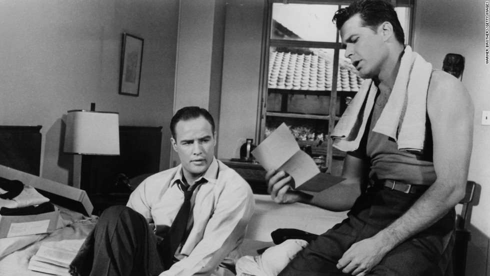 "Marlon Brando and Garner read a letter together in a scene from the 1959 film ""Sayonara."""