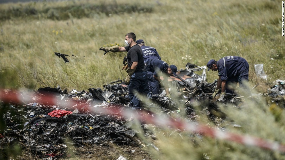 Ukrainian State Emergency Service employees sort through debris on July 20, 2014, as they work to locate the deceased.